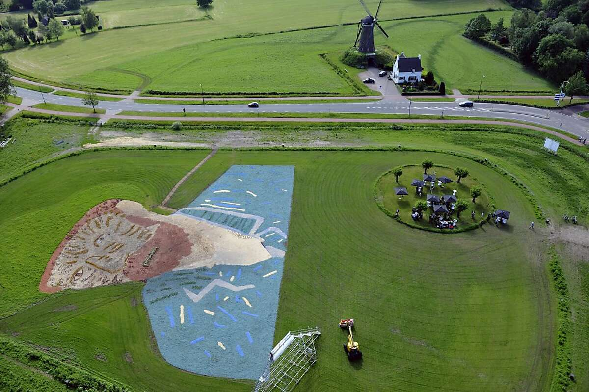 An aerial view taken on May 30, 2012 show a reproduction of the self-portrait of Duch painter Vincent van Gogh, made with wood chips and plants, in a field in Nuenen. The work measures 68 by 81 meters and lies at the foot of the Roosdonck windmill that Van Gogh also painted.