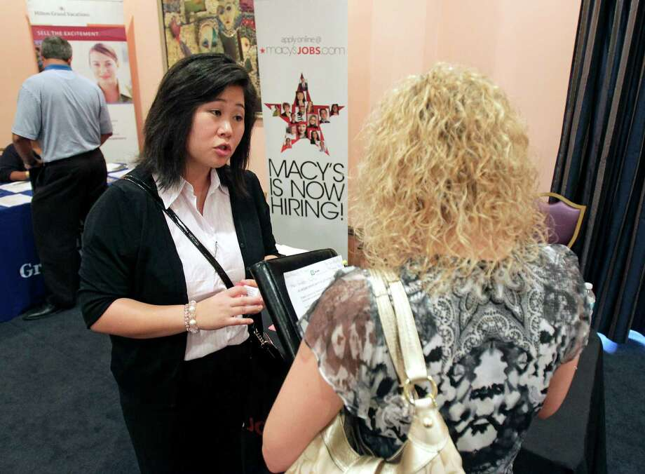 In this May 30, 2012 photo, Mi-Ran Park-Wong, of Macy's, speaks to a job applicant during a career expo sponsored by Jobs Direct USA in Orlando, Fla. The number of Americans seeking unemployment benefits rose last week to a five-week high, evidence that the job market remains sluggish. The Labor Department said Thursday, May 31, 2012 that weekly applications for unemployment aid rose 10,000 to a seasonally adjusted 383,000. (AP Photo/John Raoux) Photo: John Raoux / AP