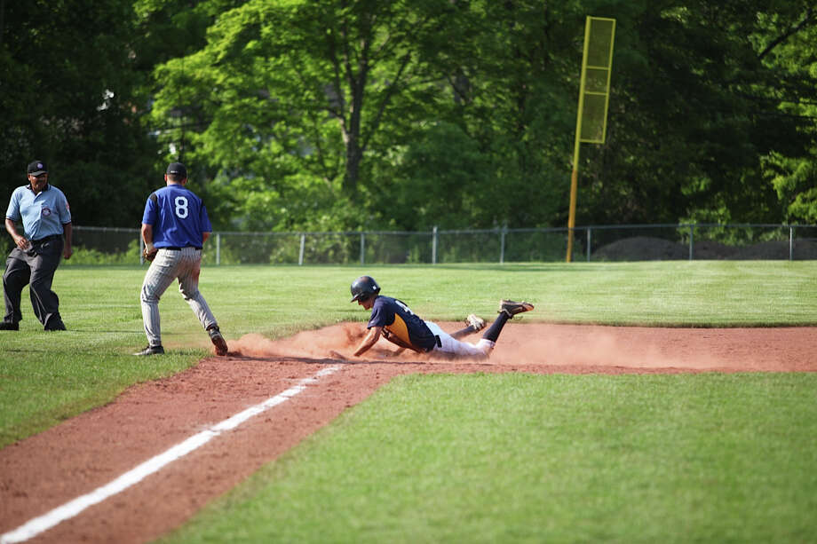 Weston's Tyler Hassett slides safely into third base Tuesday against Suffield in the first round of the Class M playoffs. Hassett helped the Trojans beat North Branford Tuesday 8-4 in the second round of Class M. Photo: Vivian Simons / Contributed Phot