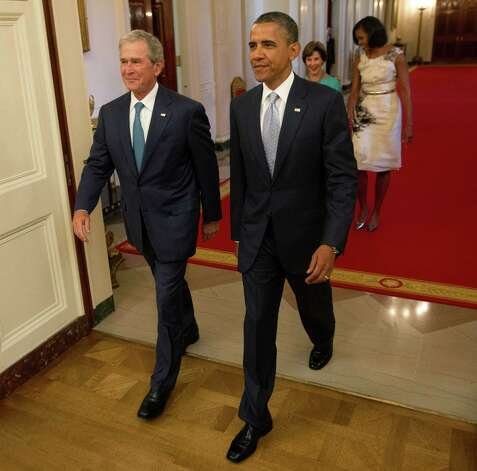 President Barack Obama and former President George W. Bush, followed by first lady Michelle Obama and former first lady Laura Bush, arrive in the East Room of the White House in Washington, Thursday, May 31,2012, for the unveiling of the Bush's portraits. Photo: Pablo Martinez Monsivais, Associated Press / AP