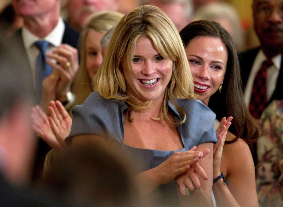 Jenna Bush, left, and her sister Barbara Bush, applaud their grandparents, former President George H.W. Bush, former first lady Barbara Bush, not seen, in the East Room of the White House in Washington, Thursday, May 31, 2012, during a ceremony to unveil their parents portraits. Photo: Carolyn Kaster, Associated Press / AP