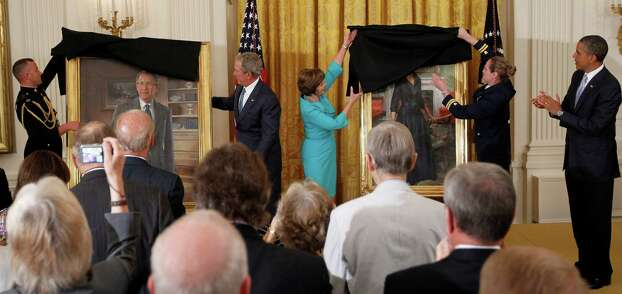 President Barack Obama applauds at right as former President George W. Bush and former first lady Laura Bush unveil the Bush portraits during a ceremony in the East Room of the White House in Washington, Thursday, May 31, 2012. Photo: Pablo Martinez Monsivais, Associated Press / AP