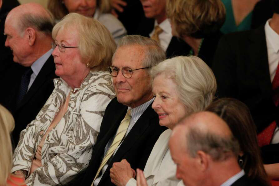 Former Secretary of Defense Donald Rumsfeld, center, is seated with others during the unveiling of t