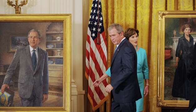 Former President George W. Bush and first lady Laura Bush, right, attend the official unveiling of their portraits at the White House in Washington, D.C., Thursday, May 31, 2012. Photo: Olivier Douliery, McClatchy-Tribune News Service / Abaca Press