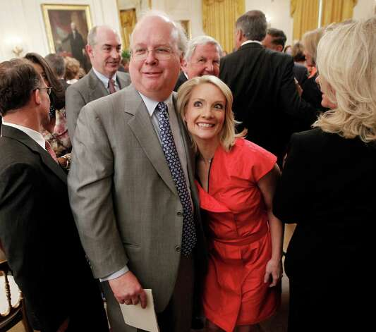 Former White House advisor Karl Rove, left, and former White House press secretary Dana Perino, right, are seen leaving the East Room of the White House in Washington, Thursday, May 31, 2012, after attending the portrait unveiling ceremony for former President George W. Bush. Photo: Pablo Martinez Monsivais, Associated Press / AP