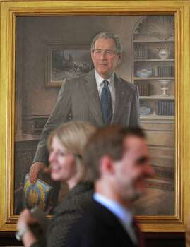 Guests walk past a portrait fo former US president George W. Bush during its unveiling May31, 2012 in the East Room of the White House in Washington, DC. Photo: MANDEL NGAN, AFP/Getty Images / AFP