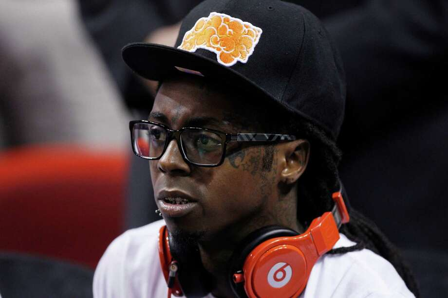 Singer Lil Wayne watches during the second half of Game 2 of the NBA basketball Eastern Conference finals playoffs series between the Miami Heat and Boston Celtics, Wednesday, May 30,  2012, in Miami. (AP Photo/Lynne Sladky) Photo: Lynne Sladky, Associated Press / AP