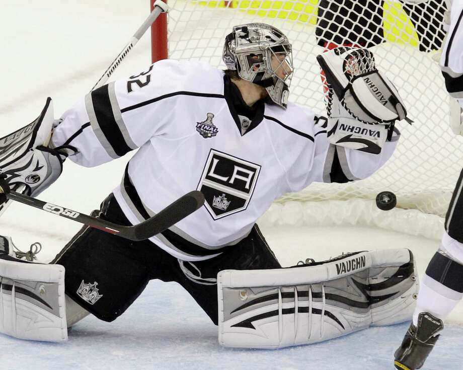 A shot by New Jersey Devils' Patrik Elias, of the Czech Republic, goes in for a goal past Los Angeles Kings' Jonathan Quick during the second period of Game 1 of the NHL hockey Stanley Cup finals Wednesday, May 30, 2012, in Newark, N.J. (AP Photo/Kathy Willens) Photo: Kathy Willens, Associated Press / AP