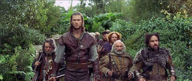"CHRIS HEMSWORTH as the Huntsman is joined by the dwarves in the epic action-adventure ""Snow White and the Huntsman"", the breathtaking new vision of the legendary tale from the producer of ""Alice in Wonderland"". Photo: Rhythm & Hues, Universal Pictures"