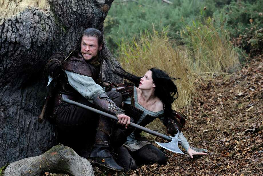 """This film image released by Universal Pictures shows Chris Hemsworth, left, and Kristen Stewart in a scene from """"Snow White and the Huntsman"""". (AP Photo/Universal Pictures, Alex Bailey) Photo: Alex Bailey"""