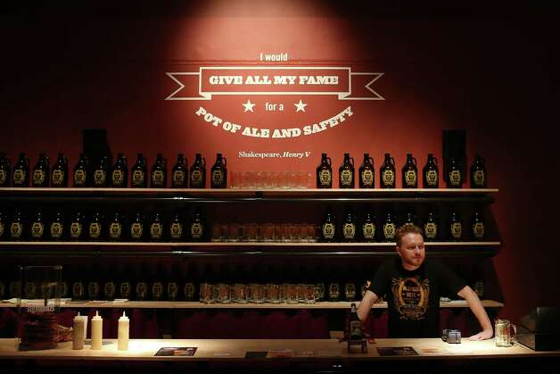NEW YORK, NY - MAY 30: Jakob Hostetter tends bar at the new exhibition at the New York Historical Society called Beer Here: Brewing New York's History on May 30, 2012 in New York City. The exhibition looks to celebrate New York's largely neglected history as an important participant in the production and consumption of beer, ale, and porter from the seventeenth century to the present. The exhibition, which goes on until September 2, includes numerous displays on early brewing in New York including an actual beer hall featuring  a selection of favorite New York City and State artisanal beers. Photo: Spencer Platt, Getty Images / 2012 Getty Images