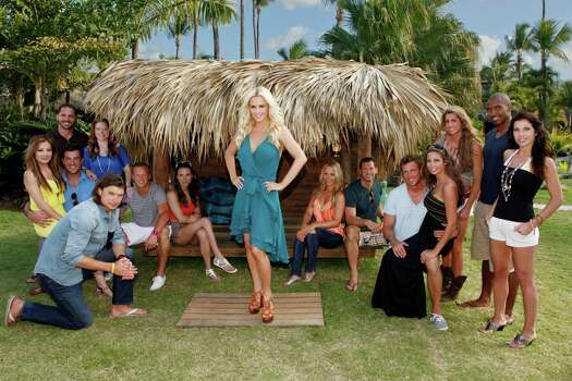 "Host Jenny McCarthy helps attractive singles attain romance in the tropics on the second season of ""Love in the Wild."" Pictured: (l-r) Benjamin Clark (on knee); Cina Luks (seated); Christian Seklecki; Aaron Chase (standing); Jenny Blatt; Jesse Wilson; Shauna Dillard; Jenny McCarthy (standing); Tara Locke; Kenneth Barrington; Tim Parrish (on knee); Ali Leitza (seated); Summer Mack (standing); Jason Holmes; Yanina Beccaria Photo: NBC, Trae Patton / NBC / 2012 NBCUniversal Media, LLC"