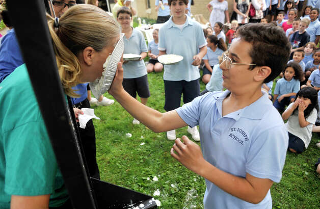 Gabriel Ortiz, 11, throws a whipped-cream pie in the face of St. Joseph ...