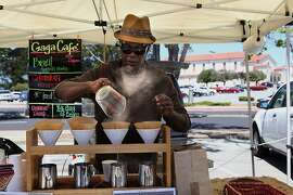 Gary Jimmerson of Gaga Cafe from Santa Rosa making coffee at his four-cup drip bar at Stonestown Farmer's Market in San Francisco, California, on Sunday, May 20, 2012.