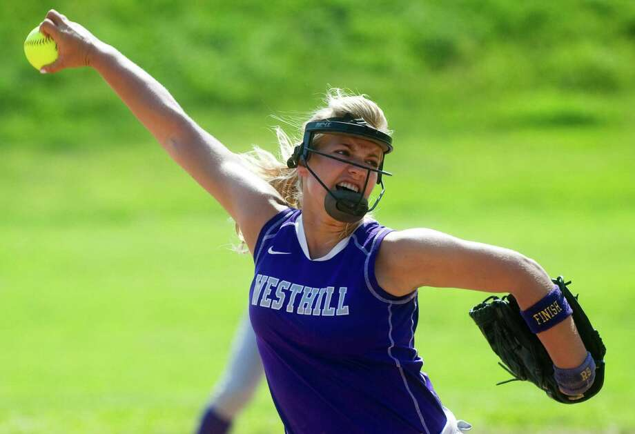 Westhill's Allison Macari throws as Westhill hosts Fairfield Warde in a Class LL softball game in Stamford, Conn., May 29, 2012. Photo: Keelin Daly / Stamford Advocate