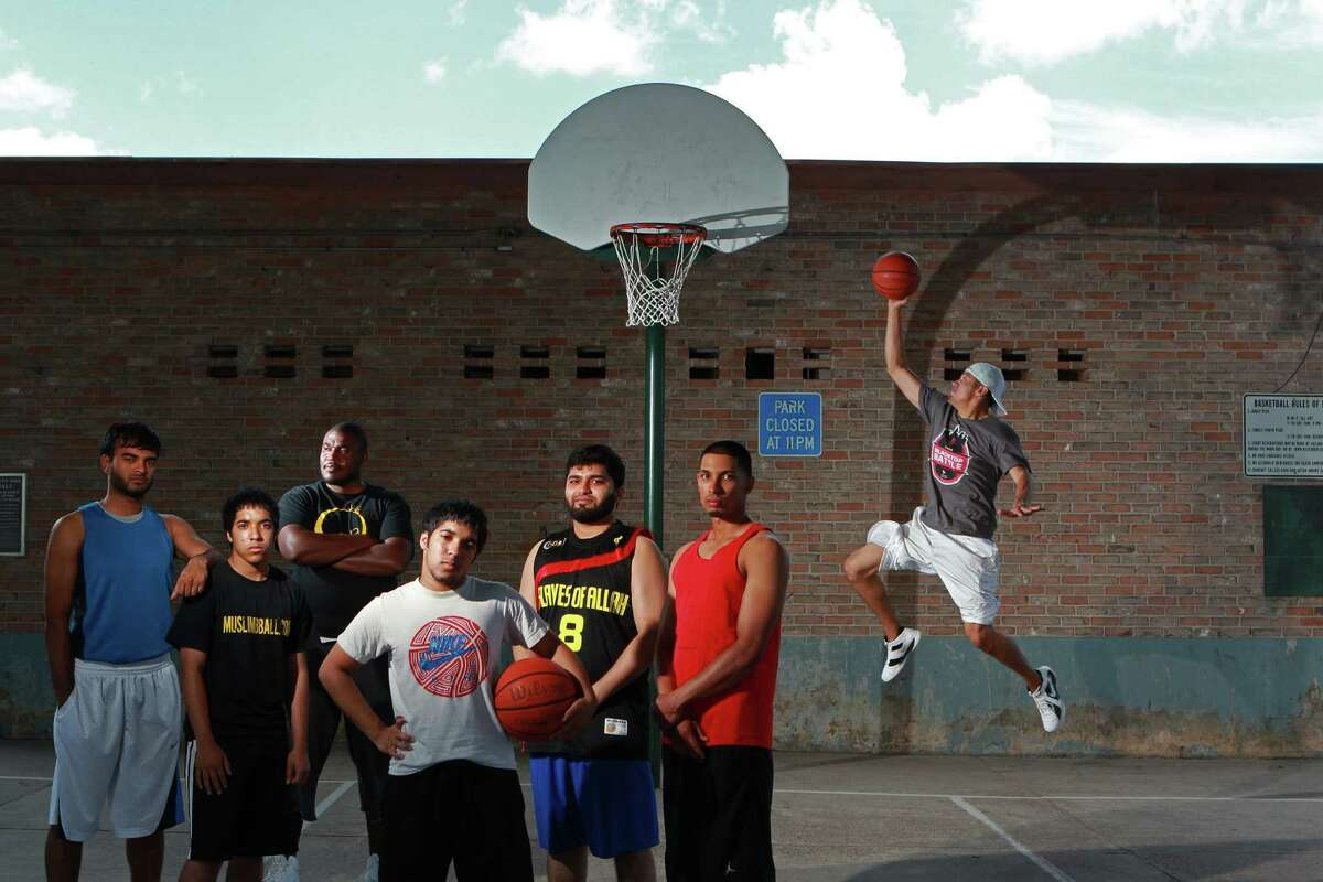 From left, Muslim basketball players Raheel Azeez, Aqib Gazi, Khary Dixon, Saqib Gazi, Aamir Kidwai, Kazeem Mohamed and Jorge Palomares at Lake Nassau Park Sunday, May 27, 2012, in Nassau Bay. ( Johnny Hanson / Houston Chronicle ) The group is one of the teams represented from the Clear Lake Islamic Center that will play in the First Annual iSlam Basketball Tournament at the University of Houston June 9 and 10.