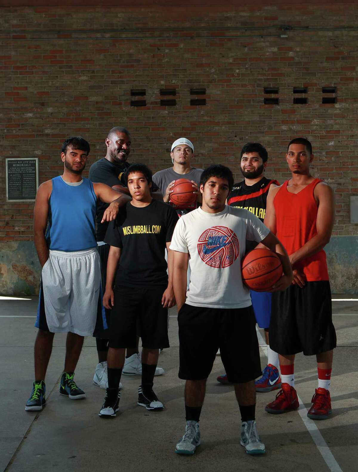 From left, Muslim basketball players Raheel Azeez, Khary Dixon, Aqib Gazi, Jorge Palomares, Saqib Gazi, Aamir Kidwai, and Kazeem Mohamed at Lake Nassau Park Sunday, May 27, 2012, in Nassau Bay. ( Johnny Hanson / Houston Chronicle ) The group is one of the teams represented from the Clear Lake Islamic Center that will play in the First Annual iSlam Basketball Tournament at the University of Houston June 9 and 10.