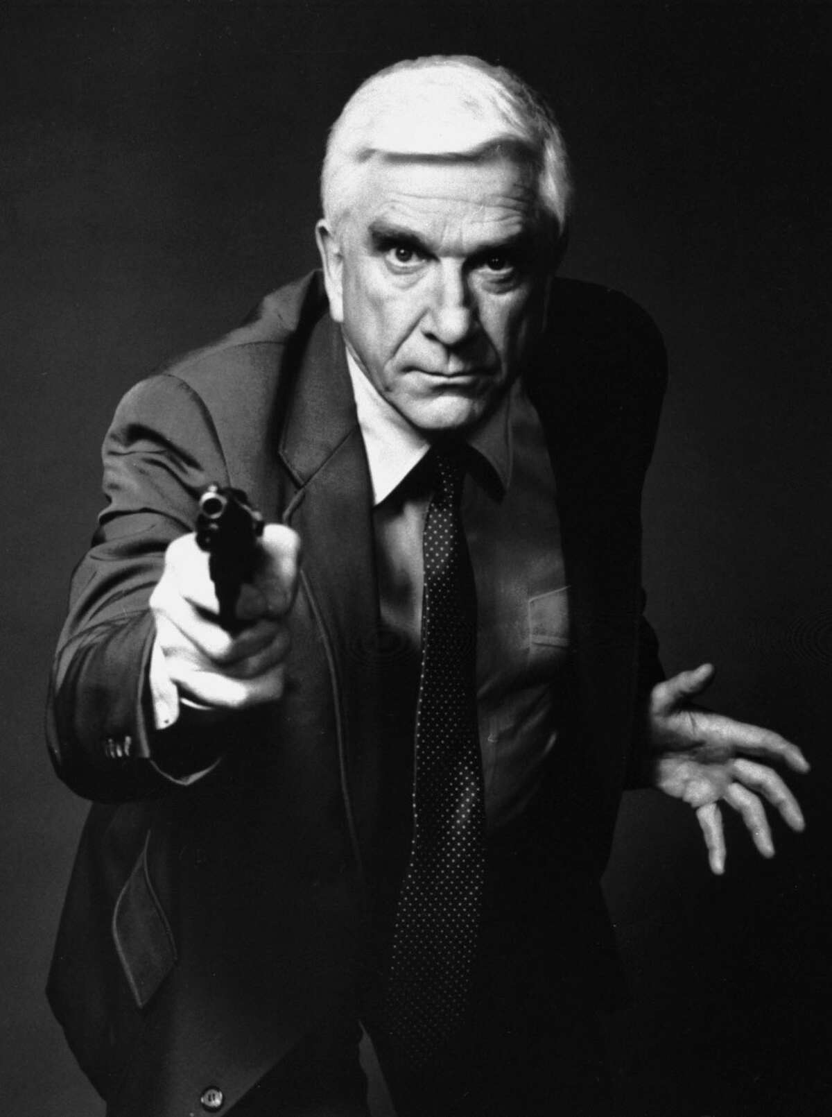 """LESLIE: This 1988 file photo provided by Paramount, shows actor Leslie Nielsen as Lt. Frank Drebin in the movie """"The Naked Gun: From the Files of Police Squad!"""" The Canadian-born Nielsen, who went from drama to inspired bumbling as a hapless doctor in """"Airplane!"""" and the accident-prone detective Frank Drebin in """"The Naked Gun"""" comedies died in 2010. (AP Photo/Paramount, File)"""