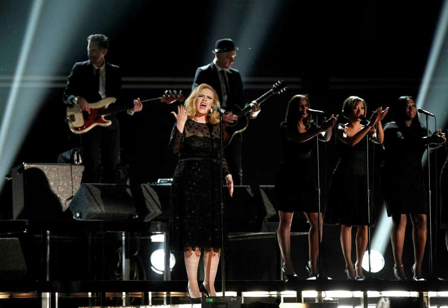 FILE - In this Feb. 12, 2012 file photo, singer Adele performs during the 54th annual Grammy Awards in Los Angeles. The Staples Center in Los Angeles will once again be the stage for the Grammy Awards, airing Feb. 10, 2013. The nominations will be revealed about two months earlier on Dec. 5 during a live primetime concert on CBS. (AP Photo/Matt Sayles, file) Photo: Matt Sayles