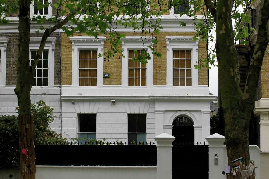 The house owned by the late British singer Amy Winehouse is seen in north London, Thursday, May 31, 2012. The family of Amy Winehouse has put the late singer's London home up for sale for 2.7 million pounds ($4.2 million).The three-bedroom property in the Camden neighborhood of northwest London had become a shrine of sorts for mourning fans who left flowers and tributes following Winehouse's death last July from alcohol poisoning. A spokesman for the Winehouse family, said Thursday May 31, 2012 that the singer had loved the house and her family put it on the market because they felt it would be inappropriate for any of them to live there..  (AP Photo/Sang Tan) Photo: Sang Tan / AP