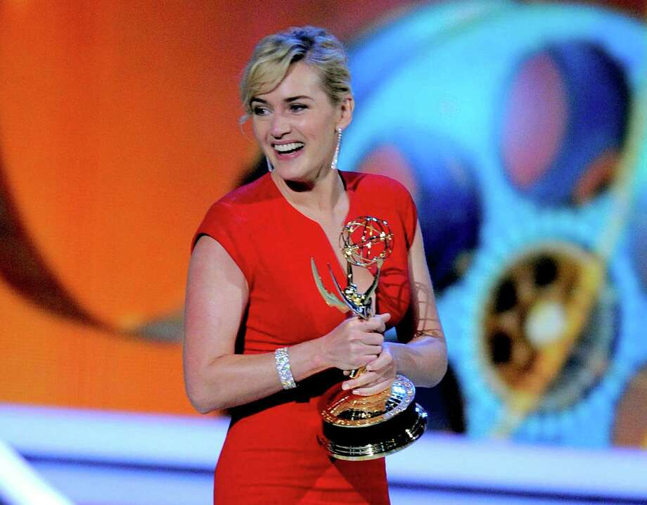 "FILE - In this Sept. 18, 2011 file photo, Kate Winslet accepts the award for outstanding lead actress in a mini-series or movie for ""Mildred Pierce"" at the 63rd Primetime Emmy Awards in Los Angeles. The Academy of Television Arts & Sciences said Thursday, May 31, 2012 that it will merge the leading and supporting acting categories for such longform programming. Starting with the 2013 awards, new categories for outstanding actor in a miniseries or TV movie and outstanding actress in a miniseries or movie will each include six nominees. Previously, the four movie and miniseries acting categories included five nominees. (AP Photo/Mark J. Terrill, file) Photo: Mark J. Terrill"
