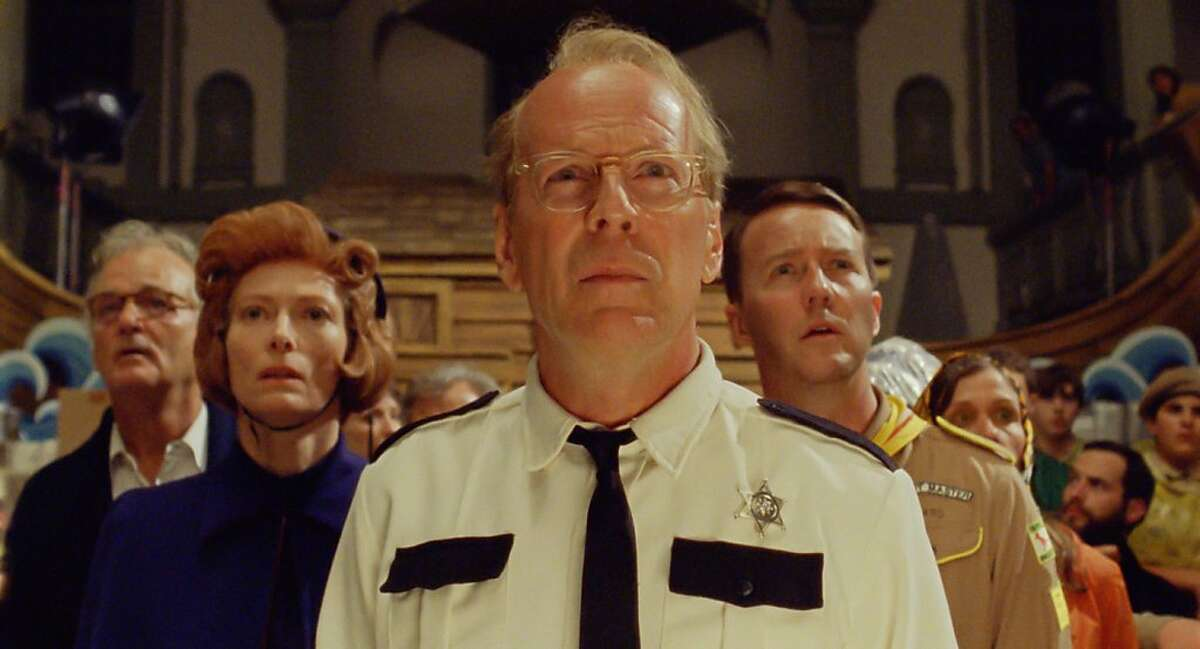 (l to r.) Bill Murray as Mr. Bishop, Tilda Swinton as Social Services, Bruce Willis as Captain Sharp, Edward Norton as Scout Master Ward, and Frances McDormand as Mrs. Bishop in Wes Anderson's MOONRISE KINGDOM, a Focus Features release. (l to r.) Bill Murray as Mr. Bishop, Tilda Swinton as Social Services, Bruce Willis as Captain Sharp, Edward Norton as Scout Master Ward, and Frances McDormand as Mrs. Bishop in Wes Anderson's MOONRISE KINGDOM, a Focus Features release. Credit: Focus Features