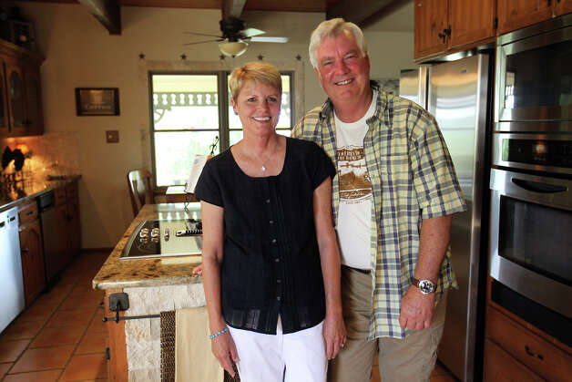 Susan and John Kuhn in their kitchen of their home in Boerne, Saturday, May 26, 2012. (JENNIFER WHITNEY) Photo: JENNIFER WHITNEY, Jennifer Whitney/ Special To The Express-News / special to the Express-News