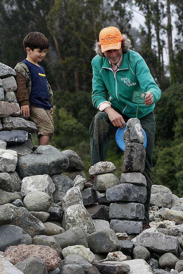 Chris Giorni putting a net on top of a rock sculpture with his four year old son Valentino Vitolo-Giorni at Crissy Field in San Francisco, California, on Monday, May 21, 2012. Photo: Liz Hafalia, The Chronicle
