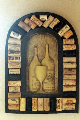 A collected cork display purchased at a Texas winery hangs on the dining room wall of the Kuhn home in Boerne, Saturday, May 26, 2012. (JENNIFER WHITNEY) Photo: JENNIFER WHITNEY, Jennifer Whitney/ Special To The Express-News / special to the Express-News