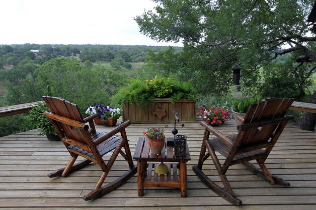 An outdoor sitting are with a a view of the Guadalupe River at the Kuhn home in Boerne, Saturday, May 26, 2012. (JENNIFER WHITNEY) Photo: JENNIFER WHITNEY, Jennifer Whitney/ Special To The Express-News / special to the Express-News