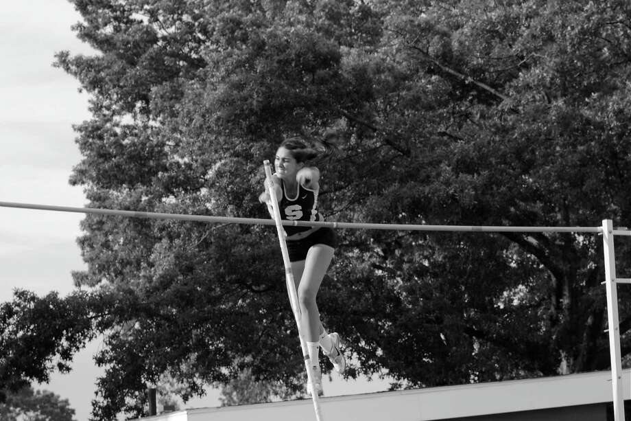 Staples' Lexie Schachne clears 12 feet in winning the pole vault at the Class LL championships Wednesday. Photo: Staplesrunning.com / Contributed