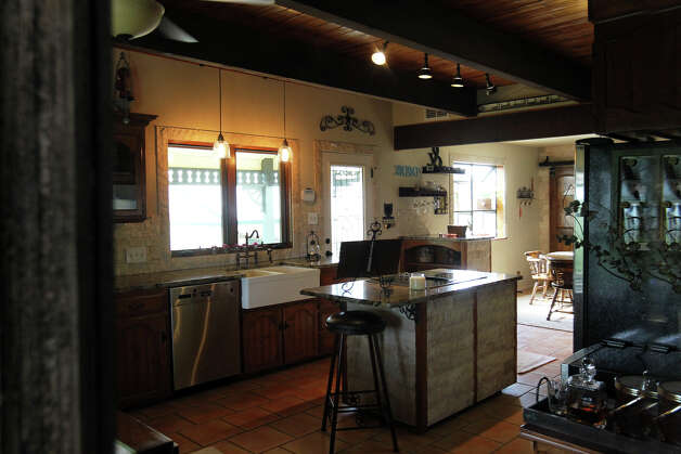 The kitchen as reflected in an antique mirror in the Kuhn home in Boerne, Saturday, May 26, 2012. (JENNIFER WHITNEY) Photo: JENNIFER WHITNEY, Jennifer Whitney/ Special To The Express-News / special to the Express-News