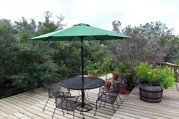 The outdoor dining area at the Kuhn home in Boerne, Saturday, May 26, 2012. (JENNIFER WHITNEY) Photo: JENNIFER WHITNEY, Jennifer Whitney/ Special To The Express-News / special to the Express-News