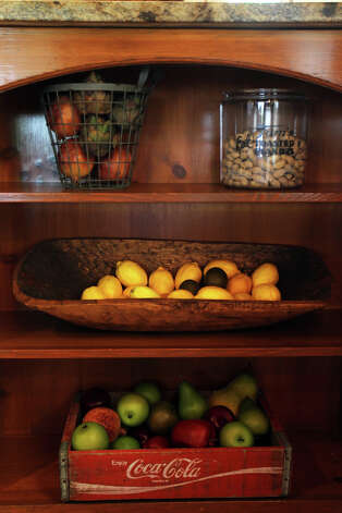 Antique containers decorate kitchen shelves in the Kuhn home in Boerne, Saturday, May 26, 2012. (JENNIFER WHITNEY) Photo: JENNIFER WHITNEY, Jennifer Whitney/ Special To The Express-News / special to the Express-News