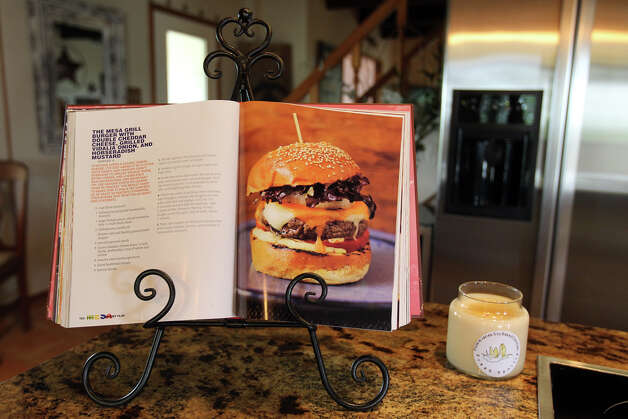 A Booby Flay cookbook open to a burger, a family favorite, rests on the kitchen island in the Kuhn home in Boerne, Saturday, May 26, 2012. (JENNIFER WHITNEY) Photo: JENNIFER WHITNEY, Jennifer Whitney/ Special To The Express-News / special to the Express-News