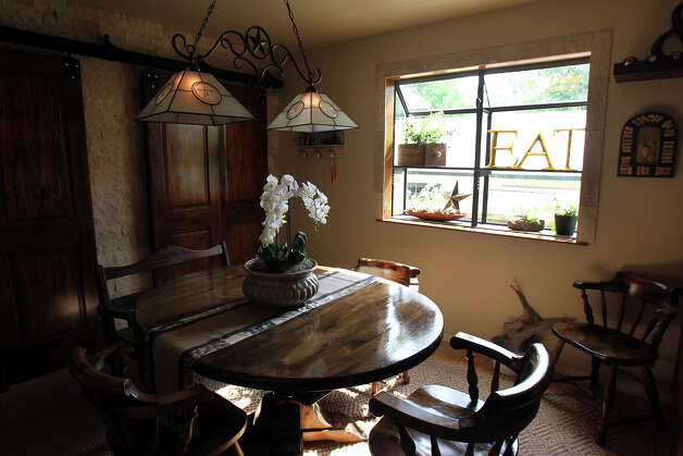 The dining room adjacent to the kitchen in the Kuhn home in Boerne, Saturday, May 26, 2012. (JENNIFER WHITNEY) Photo: JENNIFER WHITNEY, Jennifer Whitney/ Special To The Express-News / special to the Express-News