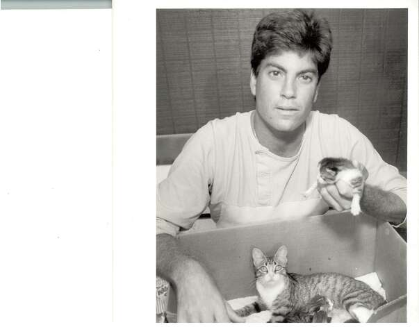 Golden Gators pitcher Steve Schefsky holds one of Dugout the cat's kittens in his hand while Dugout and three other kittens sit in a box. Dugout was the Golden Gators' adopted mascot. Photo: Enterprise File