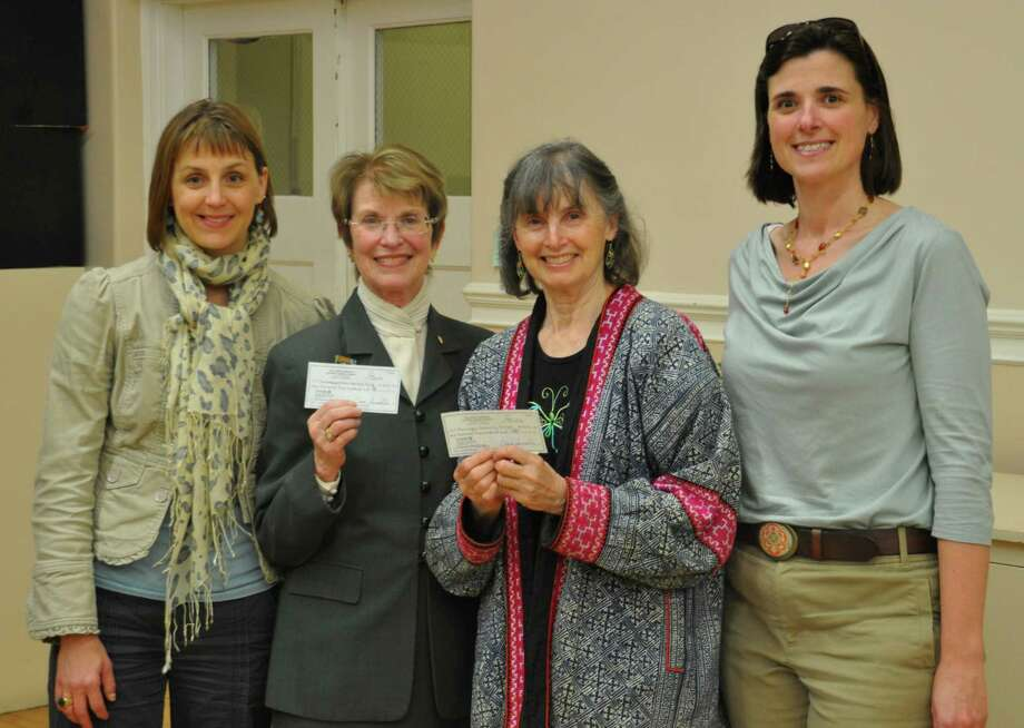 The Junior League of Eastern Fairfield County recently gave $1,500 grants to the Bridgeport Public Education Fund and the Burroughs Community Center. Pictured from left to right are Kirstin Etela, the leagueís community assistance chairwoman; Margaret Hiller, the fundís executive director; Edith Burroughs, president of the centerís board of directors; and Hannah Everard, the leagueís president. Photo: Contributed Photo