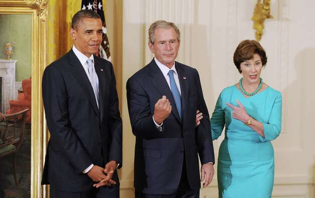 President Barack Obama, former President George W. Bush and former first lady Laura Bush attend the unveiling ceremony for the Bush's official portraits in the East Room of the White House, Thursday, May 31, 2012, in Washington, D.C. Photo: Olivier Douliery, McClatchy-Tribune News Service / Abaca Press