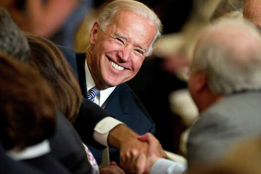 Vice President Joe Biden greets people in the East Room of the White House in Washington, Thursday, May 31, 2012, during a ceremony to unveil portraits of former President George W. Bush, and former first lay Laura Bush. Photo: Carolyn Kaster, Associated Press / AP