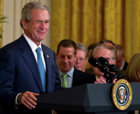 Former President George W. Bush winks in the East Room of the White House in Washington, Thursday, May 31, 2012, during a ceremony to unveil his portrait. Photo: Carolyn Kaster, Associated Press / AP