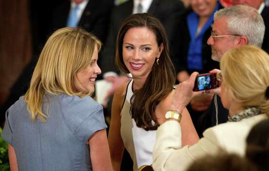 Jenna Bush, left, and Barbara Bush, right, daughters of former President George W. Bush, have their photo taken, in the East Room of the White House in Washington, Thursday, May 31, 2012, during a ceremony to unveil President Bush's portrait. Photo: Pablo Martinez Monsivais, Associated Press / AP
