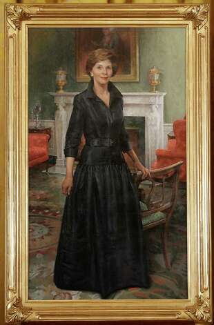 The official White House portrait of former first lady Laura Bush, by artist John Howard Sanden, is seen on stage during its unveiling ceremony, Thursday, May 31, 2012, in the East Room of the White House in Washington. Photo: Pablo Martinez Monsivais, Associated Press / AP