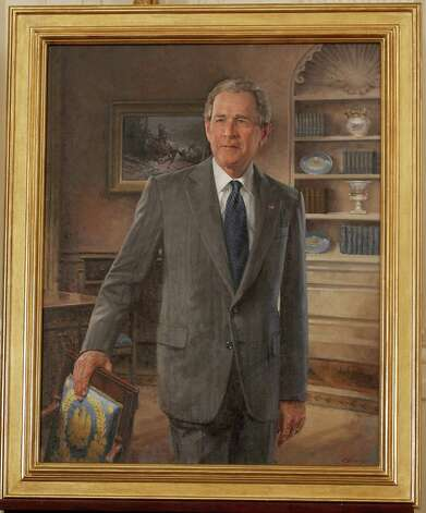 The official White House portrait of former President George W. Bush, by artist John Howard Sanden, is seen on stage during its unveiling ceremony, Thursday, May 31, 2012, in the East Room of the White House in Washington. Photo: Pablo Martinez Monsivais, Associated Press / AP