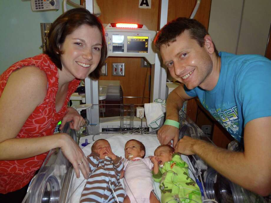This May 13, 2012, photo provided by Texas Children's Hospital shows Lauren and David Perkins of Pearland, Texas, with three of their children, from left: Benjamin, Caroline and Andrew, at the hospital in Houston. Photo: Associated Press / Texas Children's Hospital