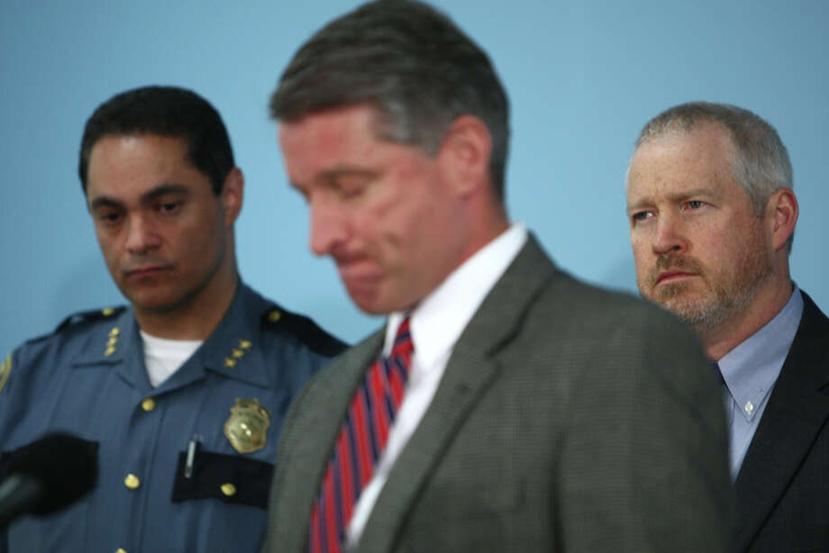 Deputy Seattle Police Chief Nick Metz, then-Assistant Chief Jim Pugel and Mayor Mike McGinn speak to reporters after a series of shootings in Seattle the previous day. Photo: JOSHUA TRUJILLO / SEATTLEPI.COM