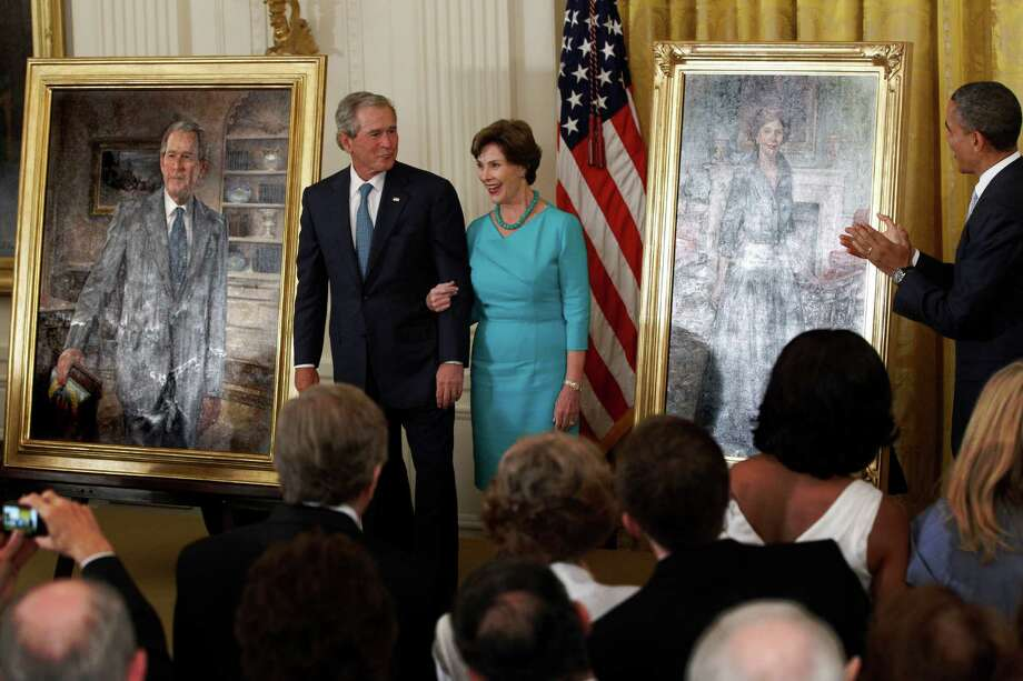 President Barack Obama applauds as former President George W. Bush and former first lady Laura Bush stand during the unveiling of their official portraits, Thursday, May 31, 2012, in the East Room at the White House in Washington. Photo: Charles Dharapak, Associated Press
