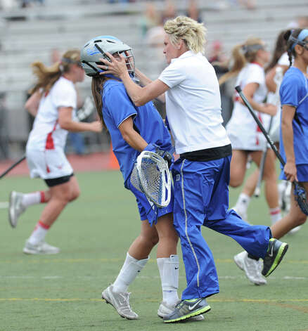 Darien High School girls lacrosse coach Lisa Lindley, right, grabs goalie Caylee Waters during a timeout in the first half of the FCIAC girls lacrosse finals against Greenwich at Brien McMahon High School in Norwalk, Friday, May 25, 2012. Darien won 17-14. Photo: Bob Luckey / Greenwich Time