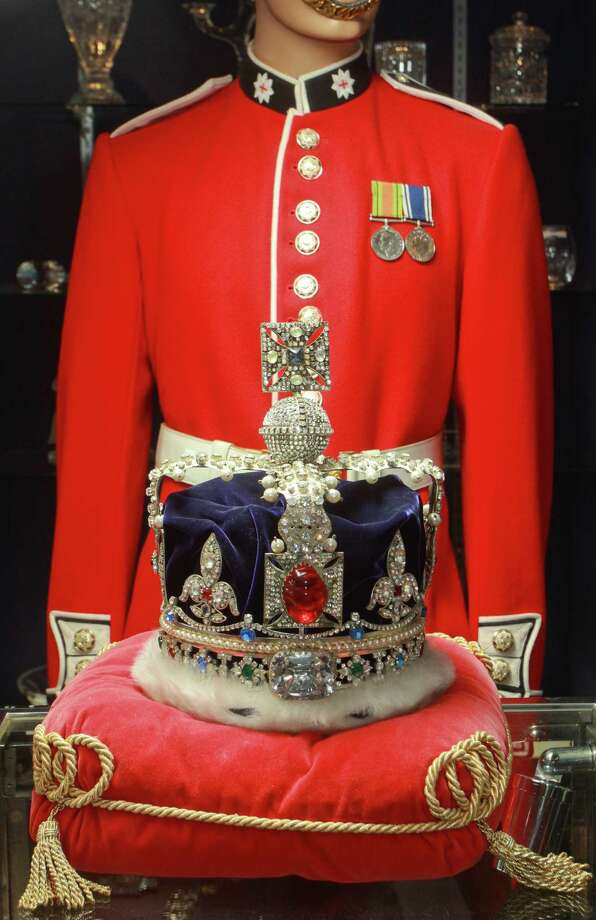 (For the Chronicle/Gary Fountain, May 30, 2012)  A replica of The Imperial State Crown on display at Houston Jewelry & Fine Gifts. The present crown was made for Queen Victoria in its present form in 1828. In the background is a uniform of The Scots Guards, a regiment of the British Army. Photo: Gary Fountain / Copyright 2012 Gary Fountain.