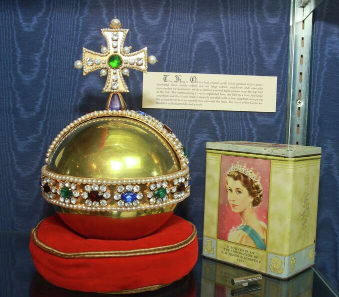 Houston Jewelry & Fine Gifts, shown here with a replica of the King's Orb and a souvenir from the co